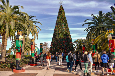 Orlando, Florida . December 24, 2018. People taking pictures with Christmas tree and nutcrackers in Lake Eola Park at Orlando Downtown area.