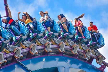 Orlando, Florida . February 17, 2019 People enjoying Mako Rollercoaster on lightblue cloudy sky background in International Drive area (8) Editorial