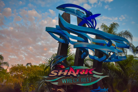 Orlando, Florida. March 09 2019. Colorful Shark sign on beautiful sunset background at Seaworld in International Drive area. 報道画像