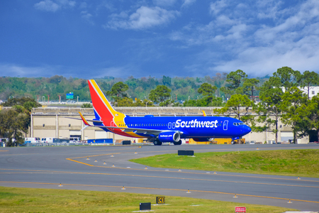 Orlando, Florida. March 01, 2019. Southwest aircraft on runway preparing for departure from Orlando International Airport (MCO) (2) Stock Photo - 121226051