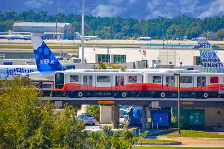 Orlando, Florida. March 01, 2019. Roll-on-off train and partial view of aircraft at Orlando International Airport (2)