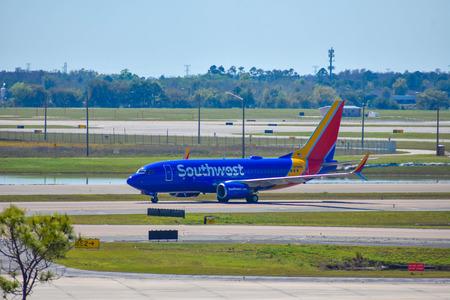 Orlando, Florida. March 01, 2019. Southwest aircraft on runway preparing for departure from Orlando International Airport (MCO) (1)