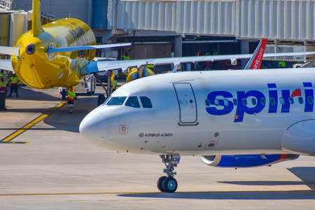Orlando, Florida. March 01, 2019. Partial view of airplane from Spirit Airlines (NK) at the gate in Orlando International Airport (MCO) (1) Editorial