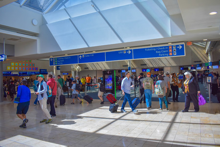 Orlando, Florida. March 01, 2019. People walking to different terminals and top view of tickets and check in at Orlando International Airport (1)