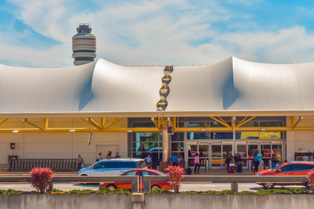 Orlando, Florida. March 01, 2019. Partial view of Terminal A and Air Traffic Control Tower at Orlando International Airport (1) Editorial