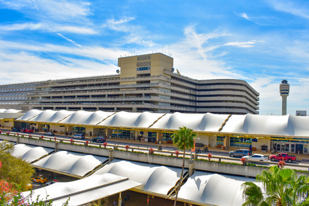 Orlando, Florida. March 01, 2019. Panoramic view of Terminal A, Parking building A partial view of Air Traffic Control Tower at Orlando International Airport (3)