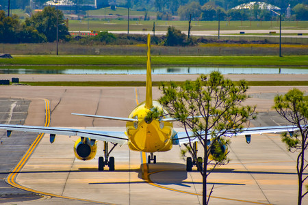 Orlando, Florida. March 01, 2019. Spirit Airlines aircraft on the runway preparing for departure from the Orlando International Airport (MCO). (2)