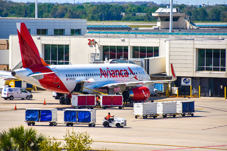 Orlando, Florida. March 01, 2019. View of airplane from Avianca Airlines (AV) at the gate in Orlando International Airport (MCO) (4) Editorial