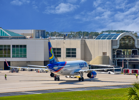 Orlando, Florida. March 01, 2019. View of airplane from Spirit Airlines (NK) at the gate in Orlando International Airport (MCO) (5) Stock Photo - 121226174