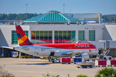 Orlando, Florida. March 02, 2019. View of airplane from Avianca Airlines (AV) at the gate in Orlando International Airport (MCO) (1) Stock Photo - 121226176