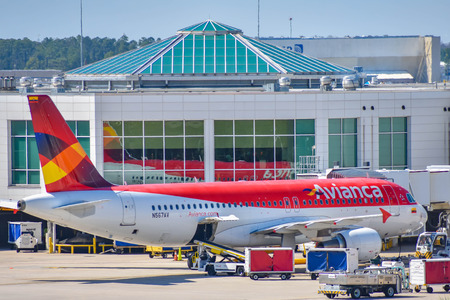 Orlando, Florida. March 01, 2019. View of airplanes from Avianca Airlines (AV) at the gate in Orlando International Airport (MCO) (2) Stock Photo - 121226177