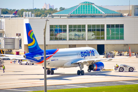 Orlando, Florida. March 02, 2019. View of airplane from Spirit Airlines (NK) at the gate in Orlando International Airport (MCO) (3) Editorial