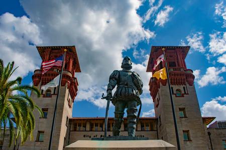 St. Augustine, Florida. March 31, 2019. Lightner Museum and Pedro Menendez de Aviles statue, in Floridas Historic Coast.