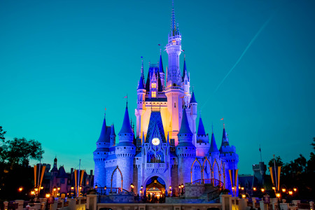 Orlando, Florida. April 02, 2019. Panoramic view of illuminated Cinderella's Castle on blue night background in Magic Kingdom at Walt Disney World (1)