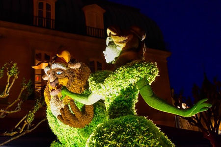 Orlando, Florida . March 27, 2019. Beauty and Beast topiaries on night background in France Pavilion at Epcot in Walt Disney World (1)