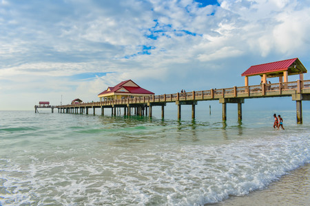 Clearwater Beach, Florida. January 25, 2019 Panoramic view of Pier 60 on lightblue cloudy background in Gulf Coast Beaches (4)