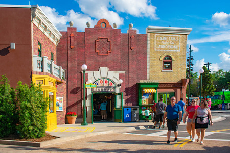 Orlando, Florida. April 7, 2019. Panoramic view of Sesame Street building and people walking at Seaworld in International Drive area. 報道画像