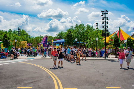 Orlando, Florida. April 7, 2019. Partial view of Cookie Drop rollercoaster and people having fun in Sesame Street Neighborhood at Seaworld. 報道画像
