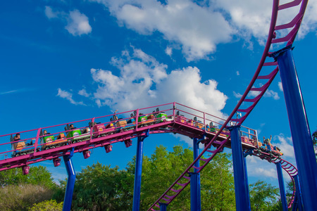 Orlando, Florida. April 7, 2019. People enjoying Cookie Drop rollercoaster family friendly attraction at Seaworld in International Drive area (6)