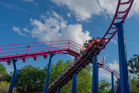 Orlando, Florida. April 7, 2019. People having fun Cookie Drop rollercoaster family friendly attraction at Seaworld in International Drive area (4) 報道画像