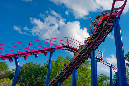 Orlando, Florida. April 7, 2019. People having fun Cookie Drop rollercoaster family friendly attraction at Seaworld in International Drive area (5) 報道画像