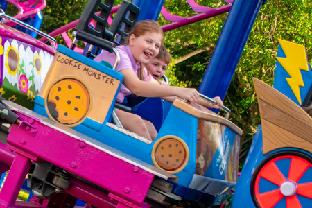 Orlando, Florida. April 7, 2019. Beautiful girl and nice little boy enjoying Cookie Drop rollercoaster at Seaworld in International Drive area.