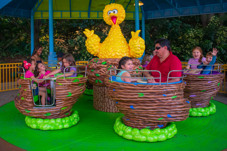 Orlando, Florida. April 7, 2019. Parent and Kids enjoying Big Birds Twirl N Whirl attraction at Seaworld in International Drive area (2)