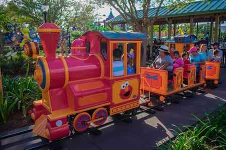 Orlando, Florida. April 7, 2019. Parent and Kids enjoying colorfur Elmos Choo Choo Train at Seaworld in International Drive area (3)