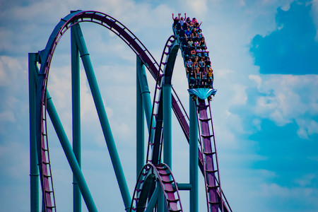 Orlando, Florida. April 7, 2019. People having fun amazin Mako rollercoaster on lightblue cloudy sky background at Seaworld in International Drive area (1)