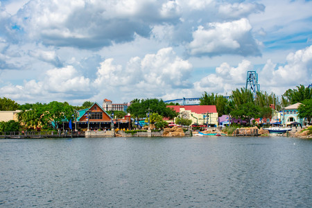 Orlando, Florida. April 7, 2019. View of Colorful restaurant, store and partial view of Manta Ray rollercoaster at Seaworld in International Drive area (1)