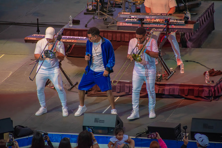 Orlando, Florida. March 17, 2019. Randy Malcom by Zone People dancing with two trumpeters from the band at Seaworld in International Drive Area (3) Редакционное