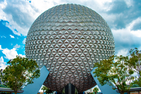 Orlando, Florida . April 02, 2019. Top view of sphere Spaceship Earth attraction on cloudy sky background at Epcot in Walt Disney World.