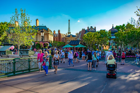 Orlando, Florida. April 02, 2019. People walking in France Pavilion area and top view of Eiffel Tower at Epcot in Walt Disney World. Фото со стока - 121384084