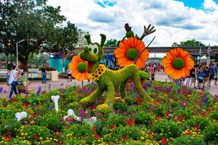 Orlando, Florida. April 02, 2019. Pluto topiarie at Epcot in Walt Disney World. Фото со стока - 121384085