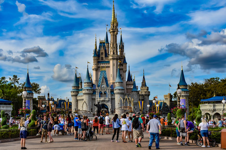 Orlando, Florida. April 02, 2019 Panoramic view of Cinderellas Castle and people walking at Epcot in Walt Disney World.