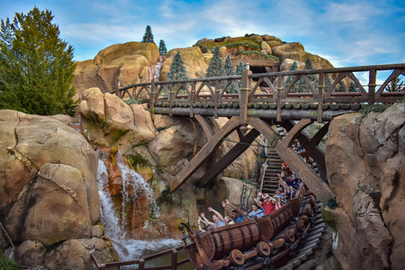 Orlando, Florida. April 02, 2019. People enjoying Seven dwarf mine train in Magic Kingdom at Walt Disney World (5) Фото со стока - 121384098