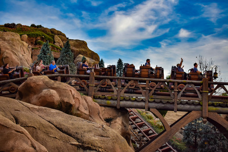 Orlando, Florida. April 02, 2019. People enjoying Seven dwarf mine train in Magic Kingdom at Walt Disney World.