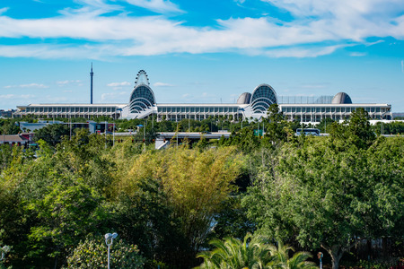 Orlando, Florida. April 20, 2019. Panoramic view of Orlando Convention Center and green forest background on lightblue sky cloudy background