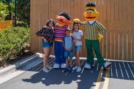 Orlando, Florida. April 20, 2019. People with Bert and Ernie in Sesame Street area. at Seaworld in International Drive area.