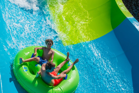 Orlando, Florida. April 20, 2019. People enjoying Karekare curl.This new ride is a curve shaped wave which will riders experience when climbing the vertical wave wall at Aquatica (3) Редакционное