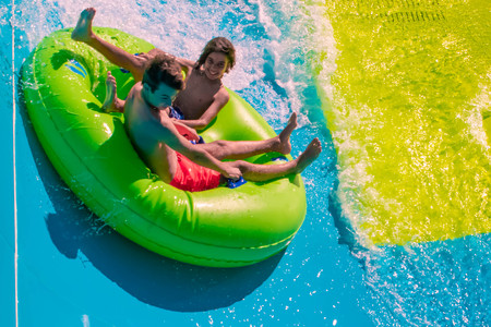 Orlando, Florida. April 20, 2019. People enjoying Karekare curl.This new ride is a curve shaped wave which will riders experience when climbing the vertical wave wall at Aquatica (9) Редакционное