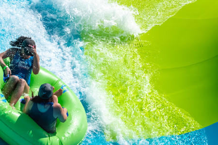 Orlando, Florida. April 20, 2019. People enjoying Karekare curl.This new ride is a curve shaped wave which will riders experience when climbing the vertical wave wall at Aquatica (10) Редакционное