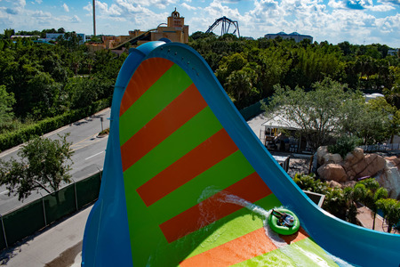 Orlando, Florida. April 26, 2019. People enjoying Karekare curl.This new ride is a curve shaped wave which will riders experience when climbing the vertical wave wall at Aquatica Фото со стока - 122360931