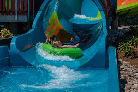 Orlando, Florida. May 20, 2019 People enjoying Karekare curl. This new ride is a curve shaped wave which will riders experience when climbing the vertical wave wall at Aquatica (33) Sajtókép