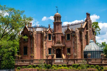 Orlando, Florida. May 16, 2019. Haunted Mansion on lightblue cloudy sky background in Magic Kingdom at Walt Disney World Resort (2)