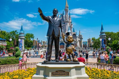 Orlando, Florida. May 16, 2019. View of Partners Statue This statue of Walt Disney and Mickey Mouse is positioned in front of Cinderella Castle in Magic Kingdom at Walt Disney World (2) 新闻类图片