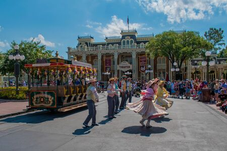 Orlando, Florida. May 17, 2019. Dancers with colorful and vintage costumes at Town Square in Magic Kingdom in the Walt Disney World area (2) Editorial