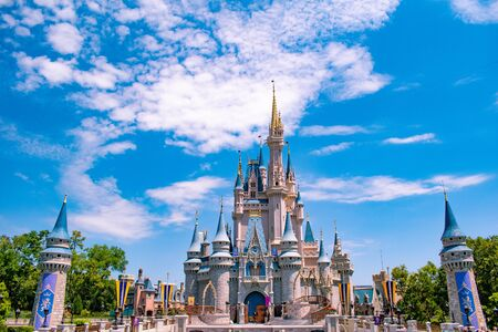 Orlando, Florida. May 17, 2019. Panoramic view of Cinderella's Castle on cloudy lightblue sky background in Magic Kingdom at Walt Disney World Resort (2)