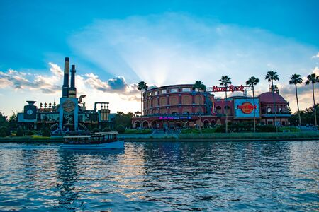 Orlando, Florida. May 22, 2019. Hard Rock Cafe on sunset background at Universal Orlando Resort in Florida with the lake on the foreground. (2)