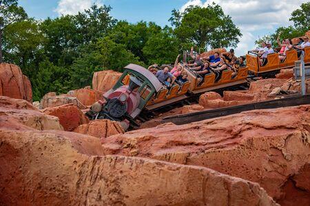 Orlando, Florida. May 10, 2019. People enjoying amazing Big Thunder Mountain Railroad on cloudy sky background in Magic Kingdom at Walt Disney World (5)